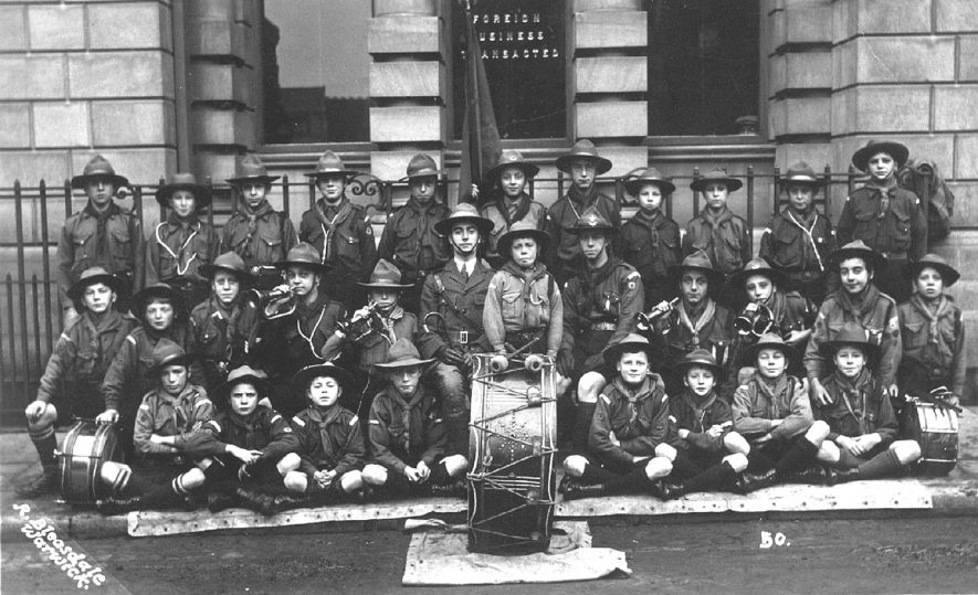 Warwick scouts and their band outside the Midland Bank in High Street.  1920s |  IMAGE LOCATION: (Warwickshire County Record Office)