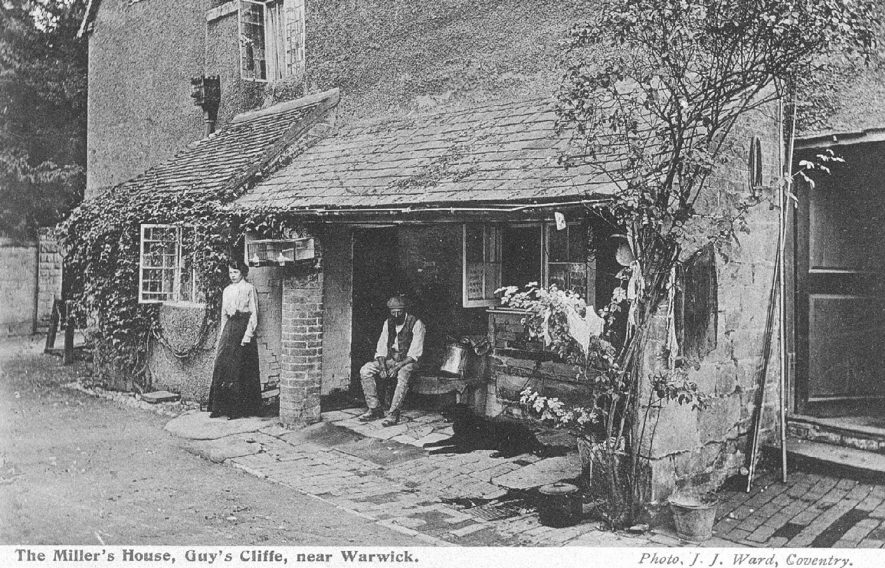 The miller and his wife outside their house, Guy's Cliffe Mill, Warwick.  1910 |  IMAGE LOCATION: (Warwickshire County Record Office)