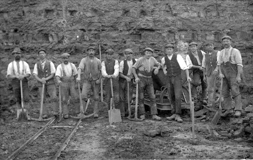 Kay's Quarry, Stockton, showing workers with picks, shovels and sledge hammers at the end of the quarry railway.  1900s |  IMAGE LOCATION: (Warwickshire County Record Office)
