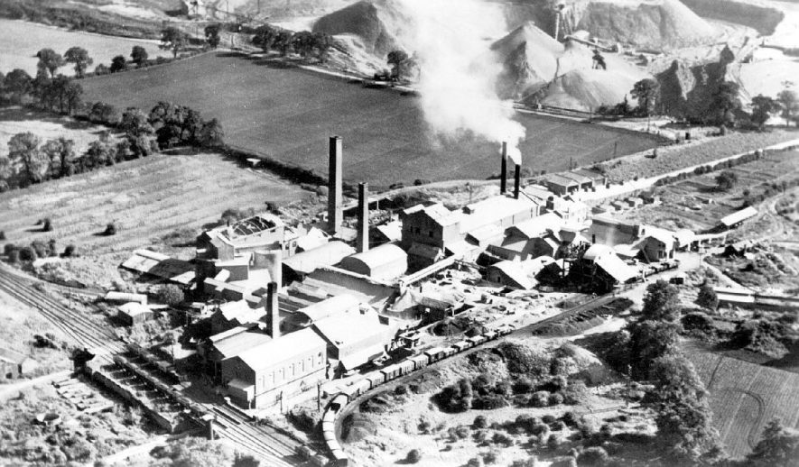 Ariel view of Nelson's Cement Works showing surrounding fields, railway and heaps of crushed limestone, Stockton.  1930s    IMAGE LOCATION: (Warwickshire County Record Office)