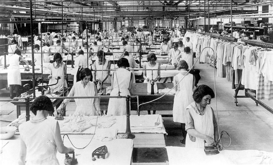 Warwick Laundry, St Nicholas Meadow, Warwick.  Interior view of the hand finishing department. Female workers using irons.  Laundry described on  back of card as