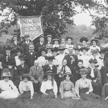 Warwick.  Group of men and women with religious banner