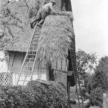 Welford on Avon.  Thatching a cottage