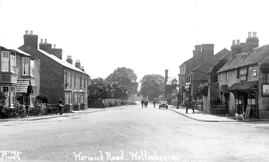 Peaceful scene in the Warwick Road, with Anslow, grocer, on the right, Wellesbourne.  1920s |  IMAGE LOCATION: (Warwickshire County Record Office)