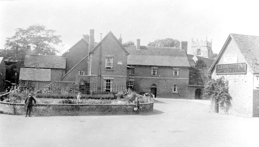 Exterior of The King's Head Hotel with the church behind. Wellesbourne.  1920s |  IMAGE LOCATION: (Warwickshire County Record Office)