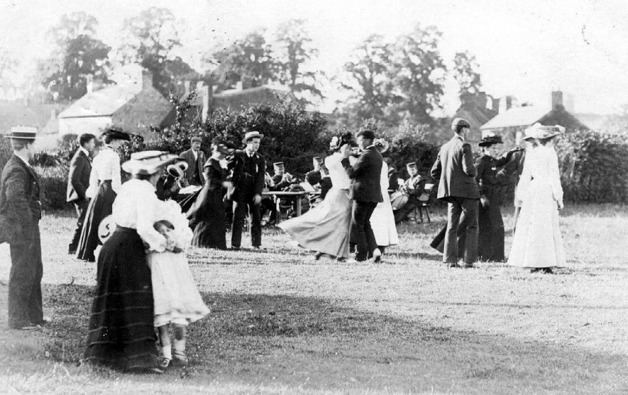 Fete? Shows people dancing to a uniformed brass band.  Postmark 1905 |  IMAGE LOCATION: (Warwickshire County Record Office)
