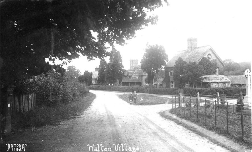 View of the estate cottages and the war memorial at Walton.  1920s |  IMAGE LOCATION: (Warwickshire County Record Office)