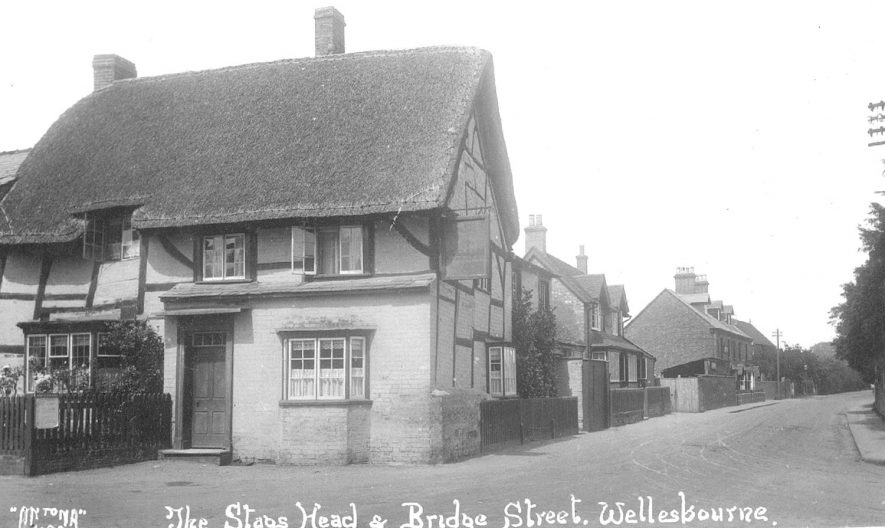 The Stags Head in Wellesbourne, a thatched, timber framed building standing on the corner of Bridge Street and Church Walk.  1920s |  IMAGE LOCATION: (Warwickshire County Record Office)