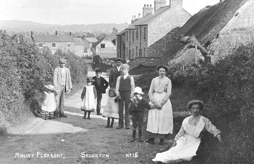 View of Mount Pleasant looking south-east with group of people in the lane, Stockton.  1900s    IMAGE LOCATION: (Warwickshire County Record Office)