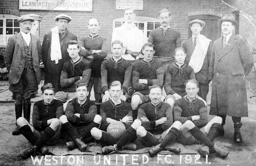 Weston United football club team photograph taken in front of The Bull's Head, Weston under Wetherley. First from the left in middle row is William Bayliss, third from left is Albert Bayliss and fifth from left in the top row is Sidney Eaton.  1921 |  IMAGE LOCATION: (Warwickshire County Record Office) PEOPLE IN PHOTO: Eaton, Sidney, Bayliss, William, Bayliss, Albert