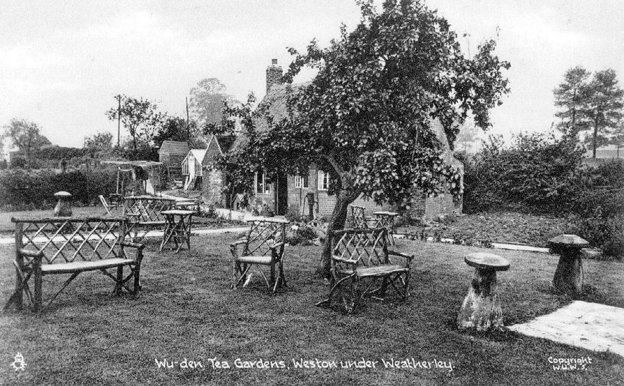 View of The Wu-den tea rooms, Weston under Wetherley. The name of these gardens was derived from the owner, Mrs Herdman Taylor's Pekinese dog called Winkie Wu.  1910s |  IMAGE LOCATION: (Warwickshire County Record Office)