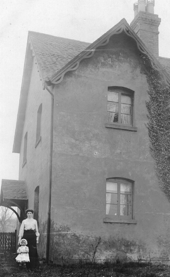 A woman and child- one of them named Maud standing outside a house at the top of Elm Row.  1900s |  IMAGE LOCATION: (Warwickshire County Record Office) IMAGE DATE: (c.1912)