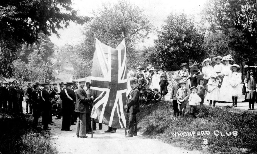Wichford Club, apparently preparing for a procession.  1910s |  IMAGE LOCATION: (Warwickshire County Record Office)