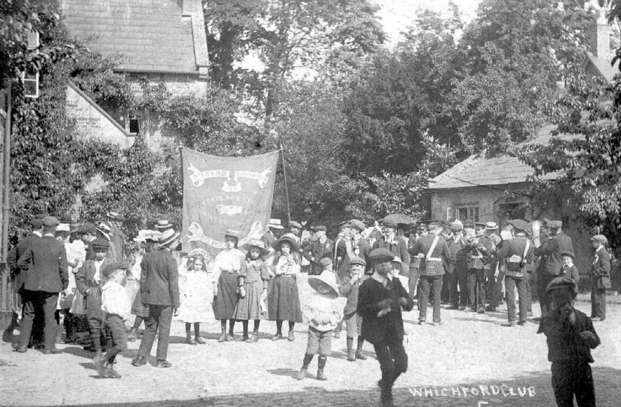 Perhaps the beginning or end of a procession with a band by Whichford Club.  1910s |  IMAGE LOCATION: (Warwickshire County Record Office)