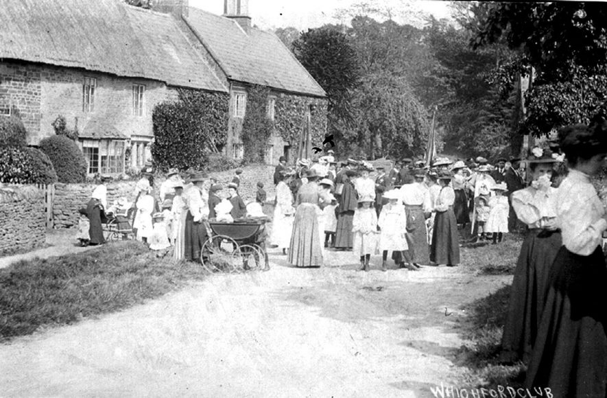 Whichford Club showing women and small children.  1910 [It is suggested that the image is taken in Ascott, looking eastwith the current post box behind the photographer.] |  IMAGE LOCATION: (Warwickshire County Record Office)