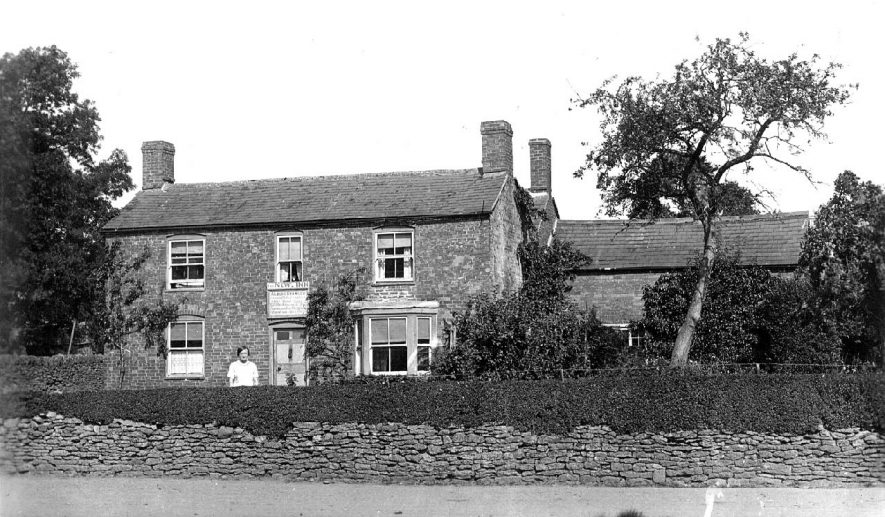 Lady standing in front of The New Inn, Whichford.  1910s |  IMAGE LOCATION: (Warwickshire County Record Office)