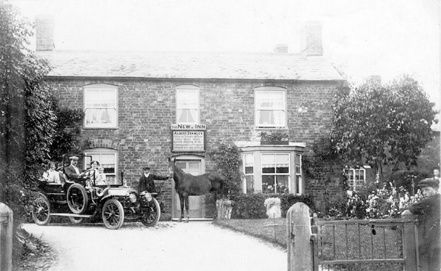 An old car and horse outside The New Inn, Whichford.  c. 1912 |  IMAGE LOCATION: (Warwickshire County Record Office) IMAGE DATE: (c.1912)