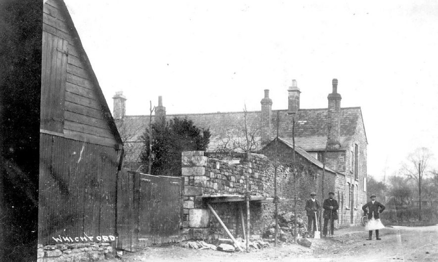 Workmen building a stone wall, using scaffolding, Whichford.  1900s |  IMAGE LOCATION: (Warwickshire County Record Office)