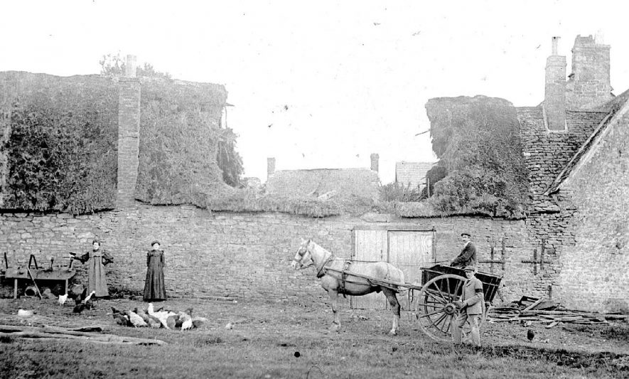 Farmyard, with roofless barn, horse and cart, two men, (one of whom is wearing a black arm band), two women and farmyard fowls, Whichford.  1900s.[It is suggested that part of the property was used by Whichford Pottery, prior to that being called Sunnyside Farm.} |  IMAGE LOCATION: (Warwickshire County Record Office)