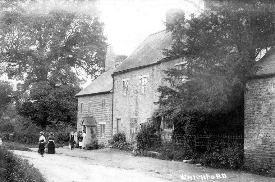Villagers standing outside two cottages in Whichford.  1910s |  IMAGE LOCATION: (Warwickshire County Record Office)