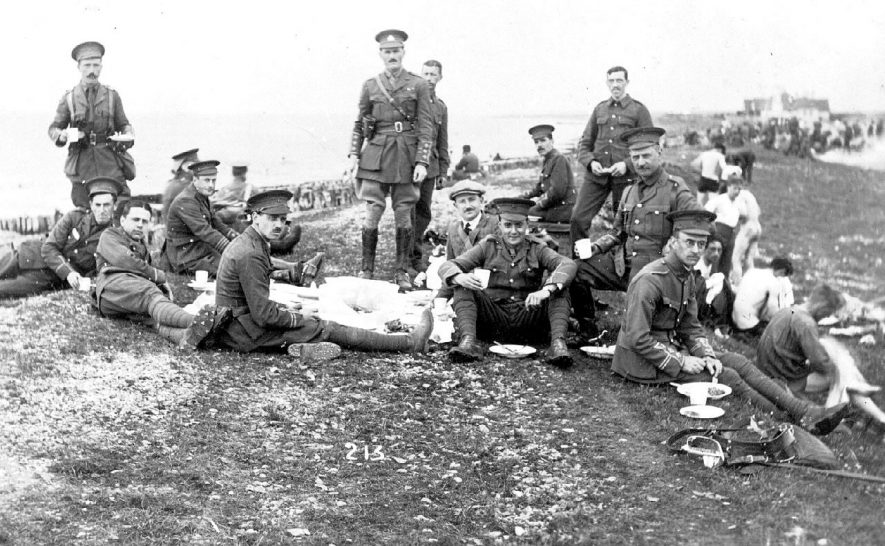 Soldiers of The Royal Warwickshire Regiment relaxing with a picnic and having a swim. Place unknown.  1910s |  IMAGE LOCATION: (Warwickshire County Record Office)