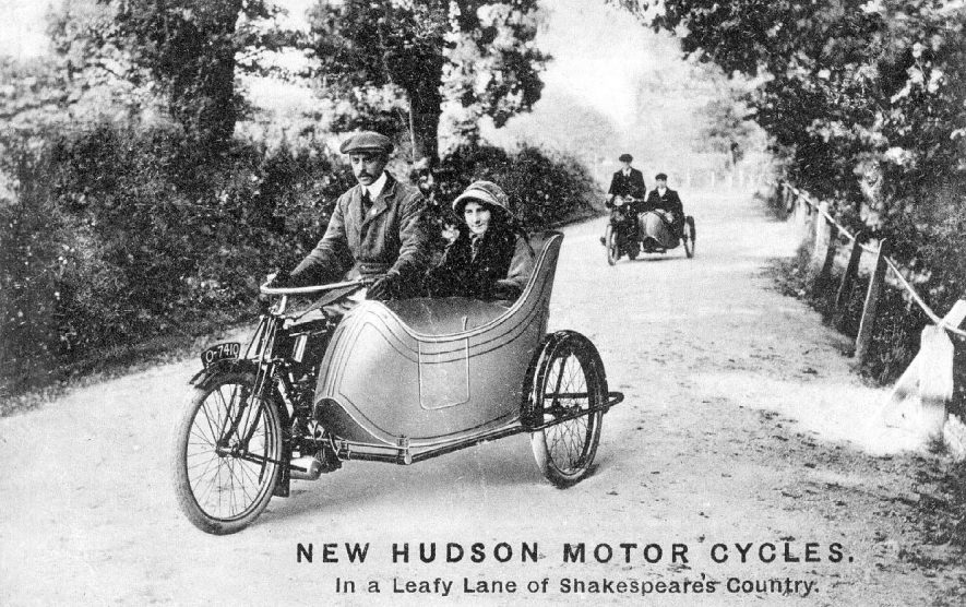 Postcard advertisement for New Hudson Motor Cycles taken in a leafy lane in Warwickshire.  1910s |  IMAGE LOCATION: (Warwickshire County Record Office)