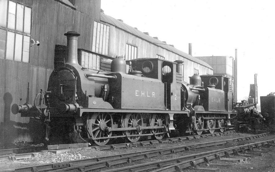 Two engines of The Edge Hill Light Railway outside the S.M.J. shed at Stratford upon Avon. 1921. See The Edge Hill Light Railway by E.S. Tanks -1948, page 21.[The correct location of this photograph is the A4390 Seven Sisters Meadow Road roundabout by Greenways car park and Old Town Mews. This was the site of the other railway station in Stratford uopn Avon. The road is in fact built upon the old trackbed] |  IMAGE LOCATION: (Warwickshire County Record Office)