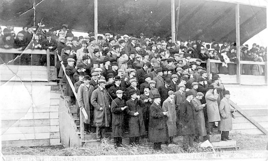 Crowd of spectators on the steps of the grandstand at the Atherstone Hunt meeting.  March 28th 1906 |  IMAGE LOCATION: (Warwickshire County Record Office)