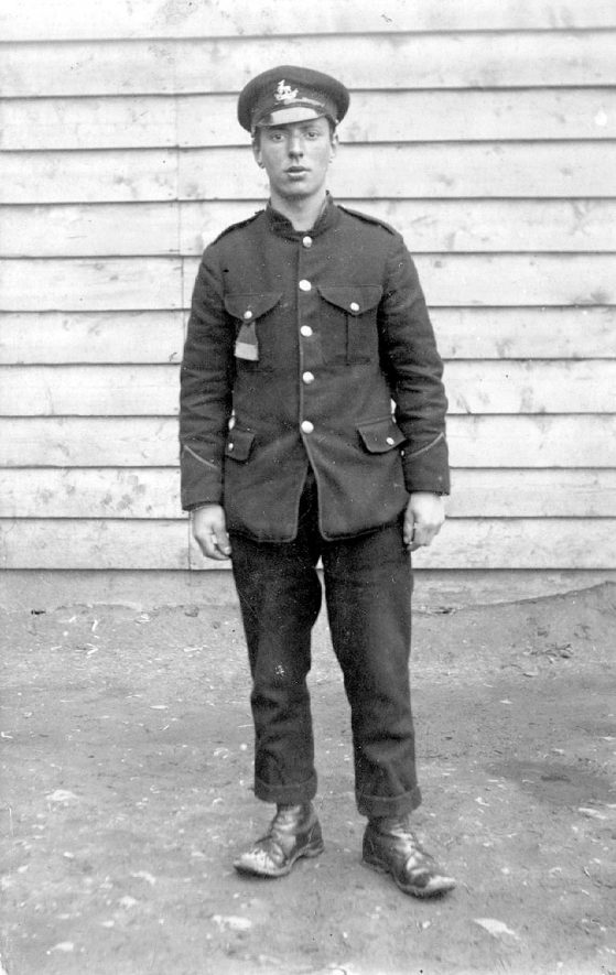 A First World War Prisoner of War minder wearing Royal Warwickshire's cap badge.  1910s [Image is of a Prisoner of War in Minden, Germany.] |  IMAGE LOCATION: (Warwickshire County Record Office)