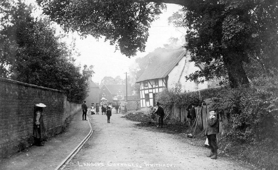 Landor's Cottages, Whitnash, with children standing in the road.  1900s |  IMAGE LOCATION: (Warwickshire County Record Office)