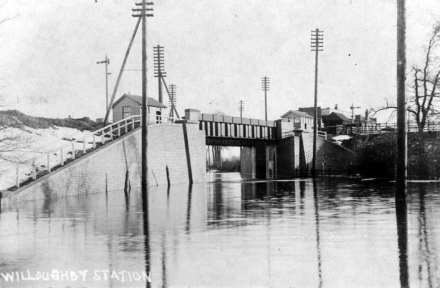 Willoughby railway station and bridge over the flooded A45 road.  1900s |  IMAGE LOCATION: (Warwickshire County Record Office)