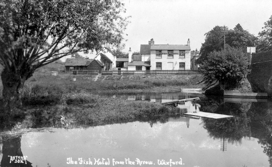 The Fish Hotel fronting onto the river Arrow in Wixford.  1920s |  IMAGE LOCATION: (Warwickshire County Record Office)