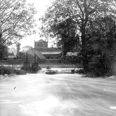 Wolston.  Floods in front of the Church