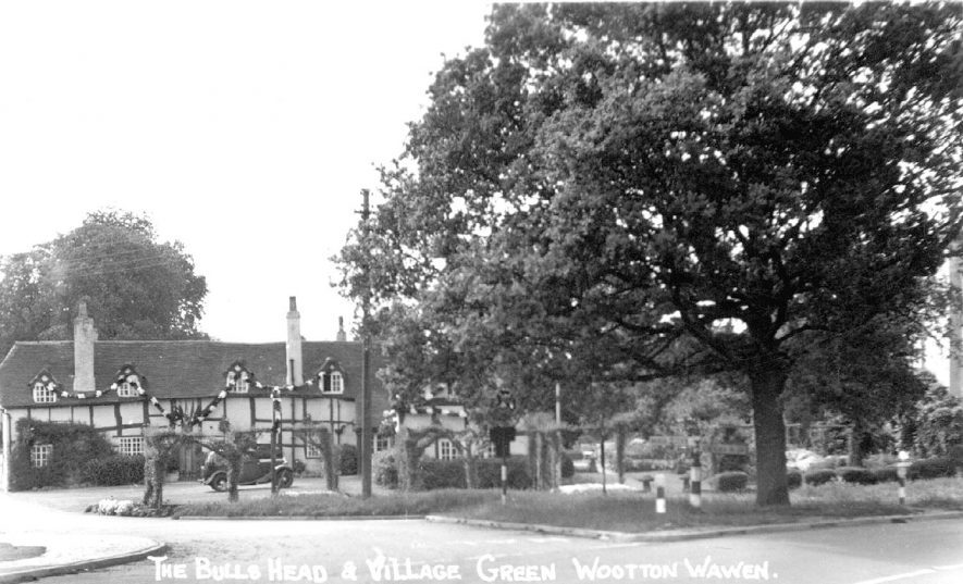 The Bulls Head Inn and the village green, Wootton Wawen.  1930s |  IMAGE LOCATION: (Warwickshire County Record Office)
