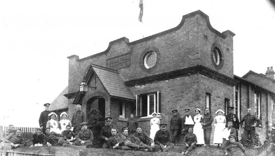 Staff and patients outside the Red Cross hospital for service personnel during the first world war, Henley in Arden.  c. 1917 |  IMAGE LOCATION: (Warwickshire County Record Office)