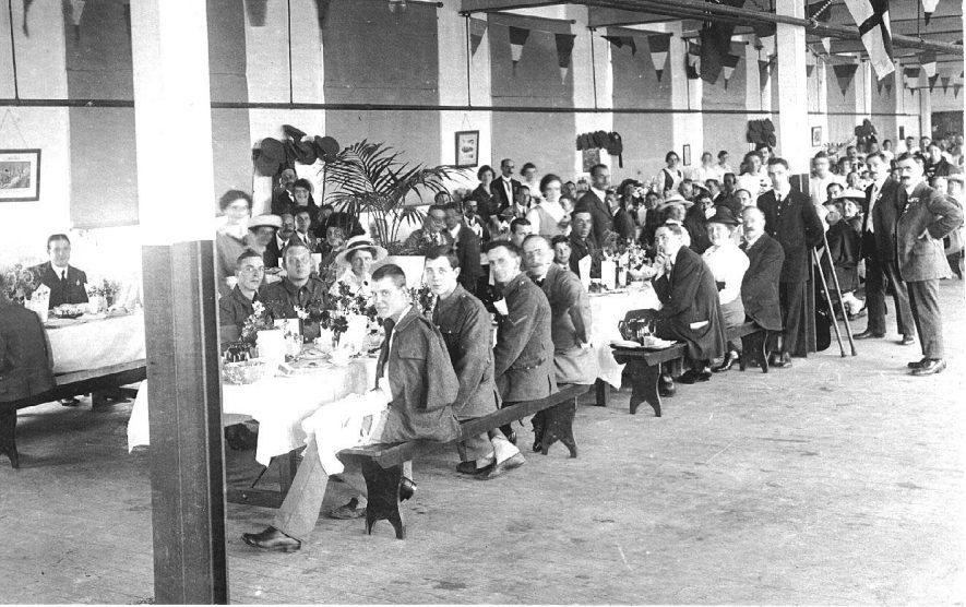 A meal being served at the Red Cross hospital, Henley in Arden.  c. 1917 |  IMAGE LOCATION: (Warwickshire County Record Office)