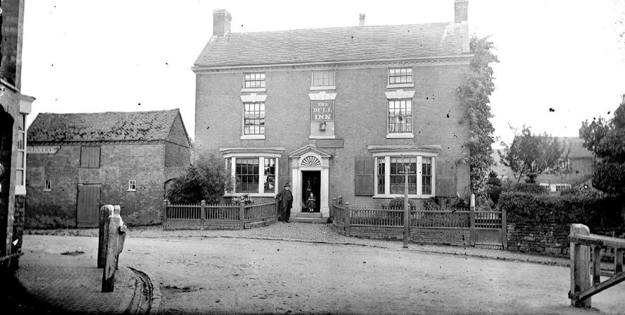 Bull Inn at Attleborough with gentlemen and child standing outside.  1900s |  IMAGE LOCATION: (Warwickshire County Record Office)