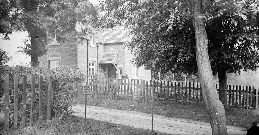 Camp Hill Lodge, Nuneaton, with residents.  1900s    IMAGE LOCATION: (Warwickshire County Record Office)