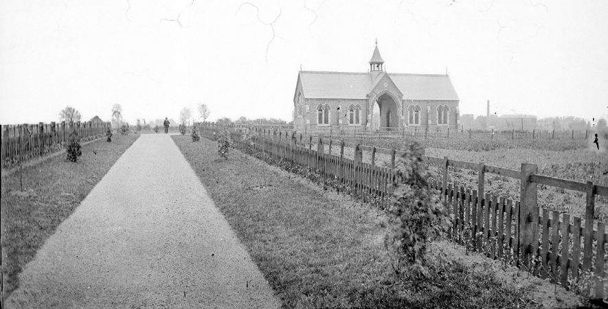 The chapel at Nuneaton cemetery with gentleman standing at end of path.  1900s |  IMAGE LOCATION: (Warwickshire County Record Office)