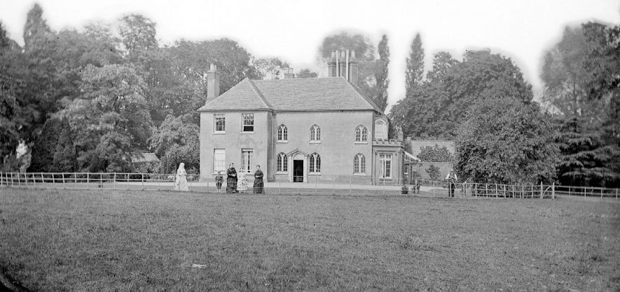 Coton Hall with its residents and gardener.  1900s |  IMAGE LOCATION: (Warwickshire County Record Office)
