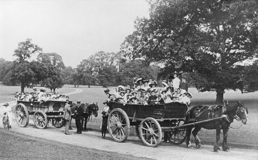 Alcester Sunday School outing to Ragley Park, showing two large carts drawn byhorses. 1914 |  IMAGE LOCATION: (Warwickshire County Record Office)
