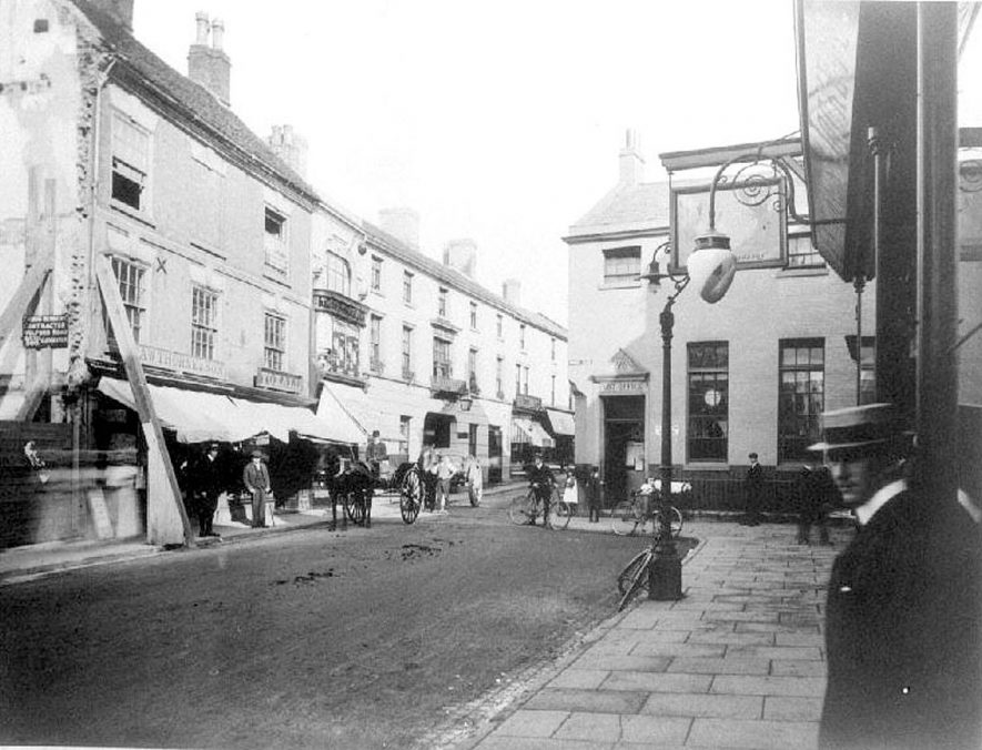 Bridge Street looking towards Market Place showing Cawthorne's & Son Photographers shop, Nuneaton.  1900s |  IMAGE LOCATION: (Warwickshire County Record Office)