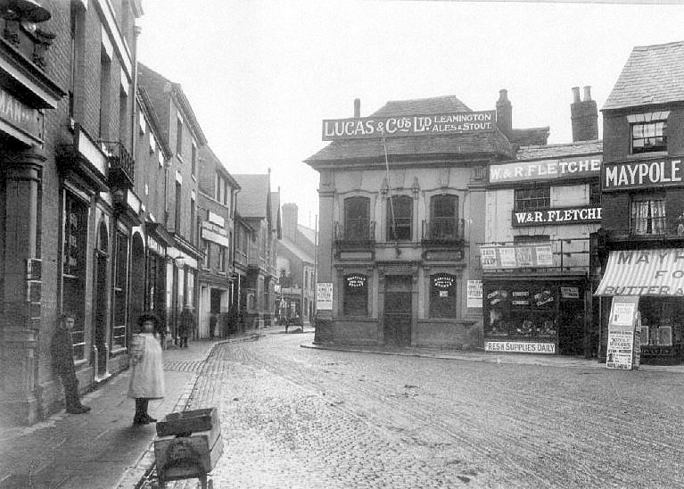 Market Place, Nuneaton showing The Crystal Palace Hotel, The Maypole and W.R. Fletcher's.  1900s    IMAGE LOCATION: (Warwickshire County Record Office)