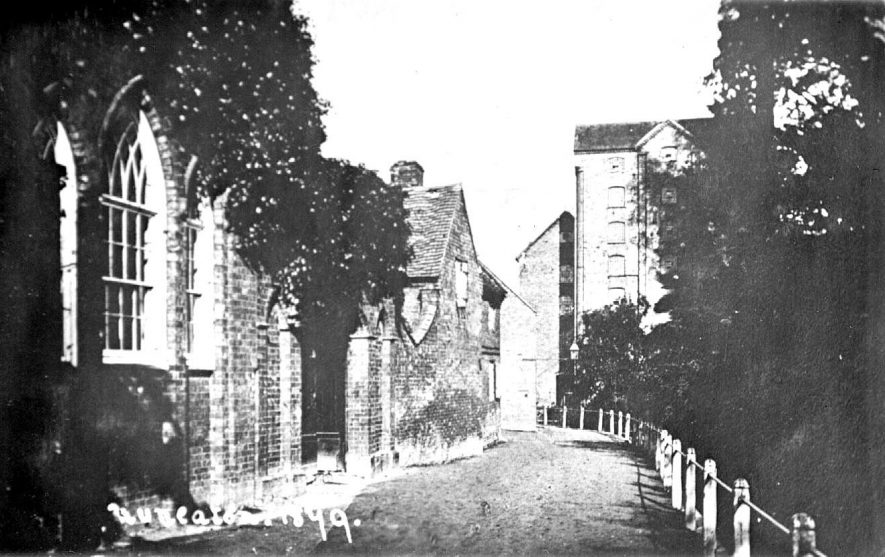 Mill Walk, Nuneaton with Charity School on the left.  1879 |  IMAGE LOCATION: (Warwickshire County Record Office)