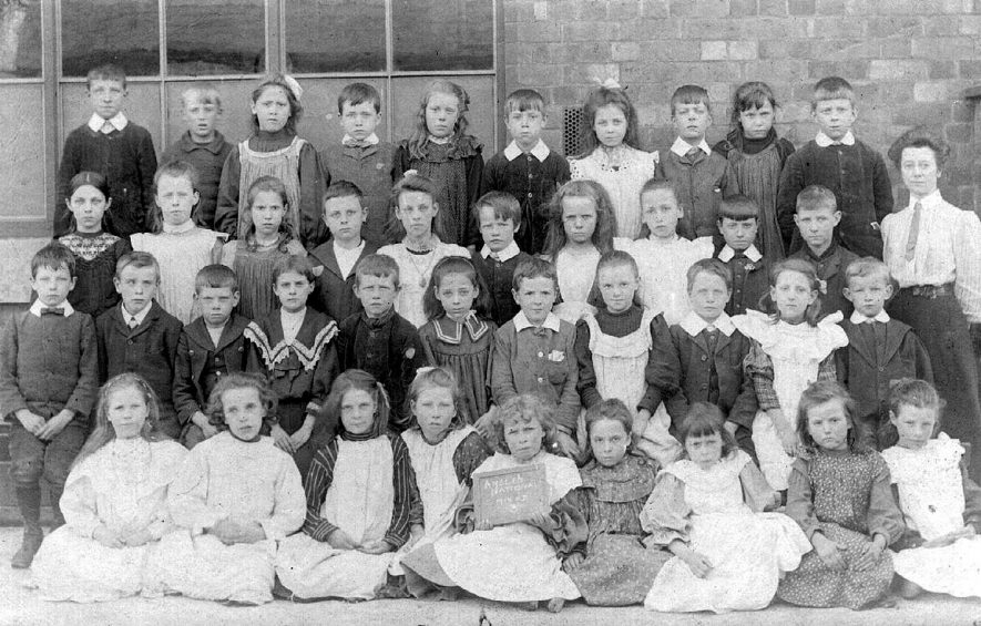 Ansley National school class three and teacher.  1900s |  IMAGE LOCATION: (Warwickshire County Record Office)