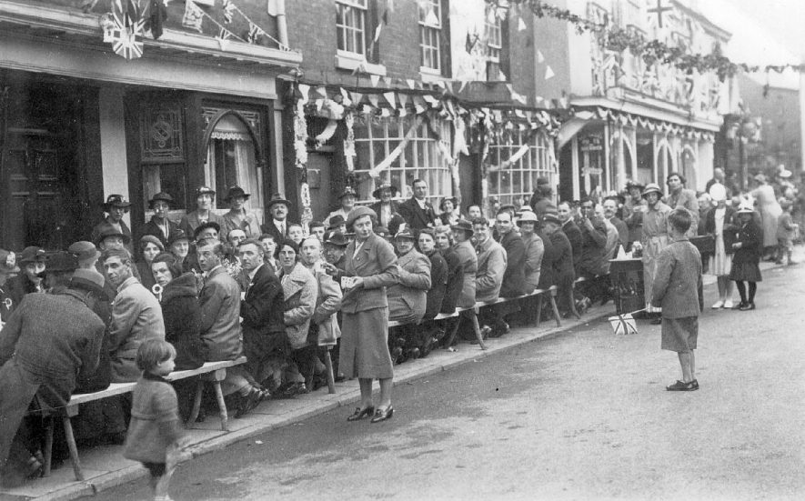 Street party on Coronation Day 1937, High Street, Alcester. |  IMAGE LOCATION: (Warwickshire County Record Office)