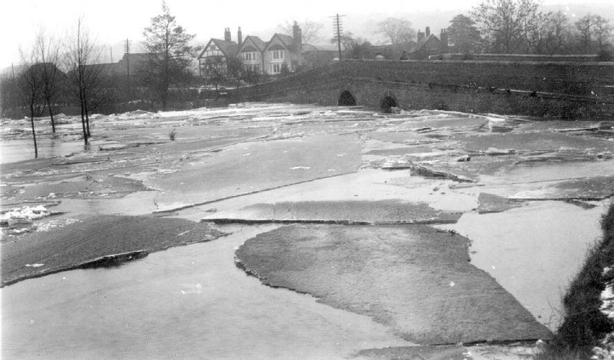 River Arrow at Alcester in 1940 after the big freeze, showing sheets of ice and the river in flood.