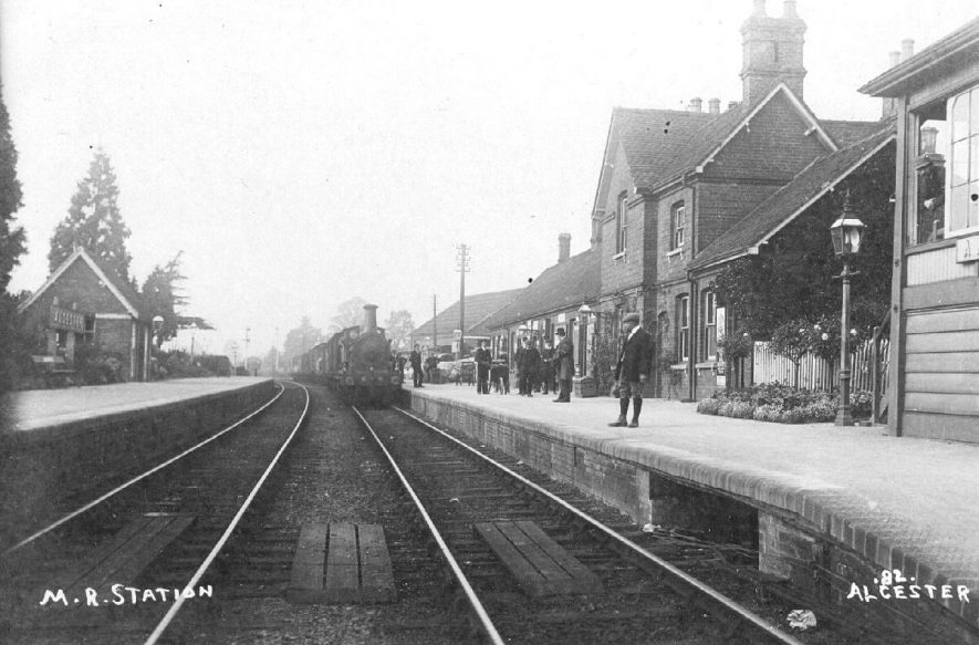 Midland Railway station showing goods train arriving awaited by staff, Alcester.  1900s |  IMAGE LOCATION: (Warwickshire County Record Office) SCAN DATE: (1/1197)