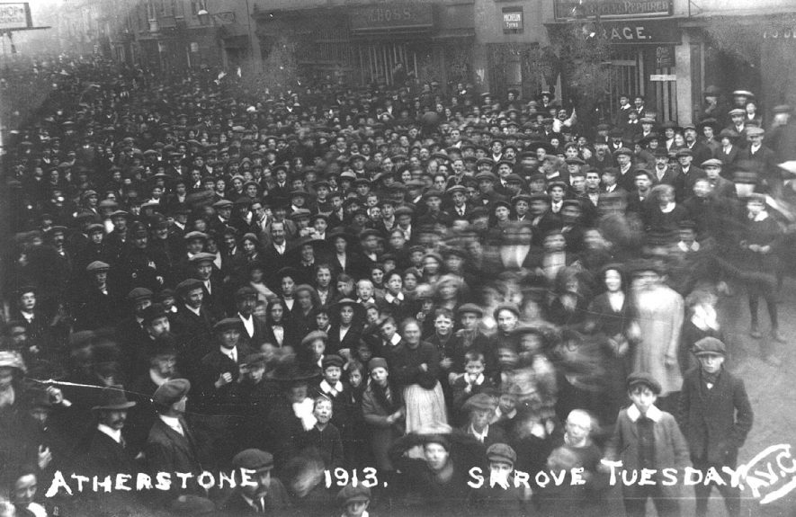 Crowd in street on Shrove Tuesday, possibly waiting to see traditional football match, Atherstone.  1913 |  IMAGE LOCATION: (Warwickshire County Record Office)