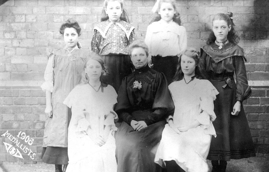 Infant School girl medallists with teacher, Atherstone.  1906 |  IMAGE LOCATION: (Warwickshire County Record Office)